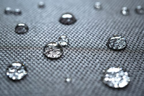 Waterproof coating background with water drops