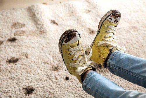 Muddy Carpet and Sneakers
